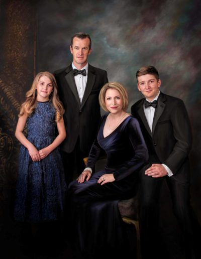 Painted portrait of a family wearing evening gowns and tuxedos