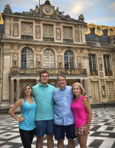 Family portrait standing in front of painted 1800's building