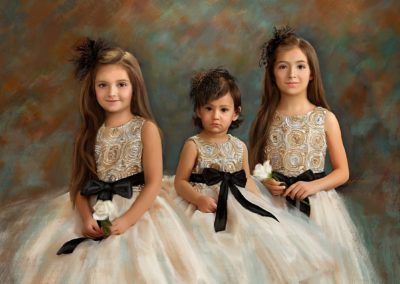 Painting of three little girls sitting next to each other