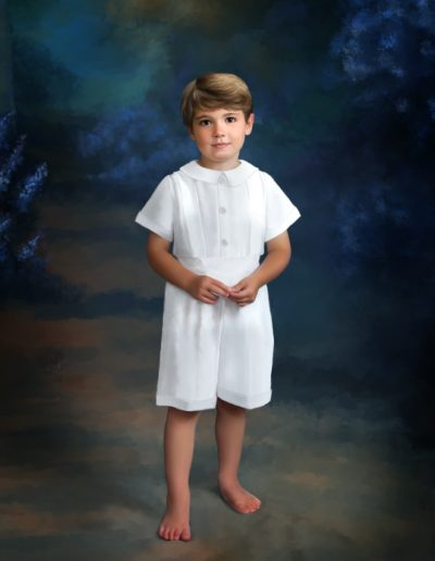 Painting of a little boy dressed in white jumper standing on a path between purple flowers