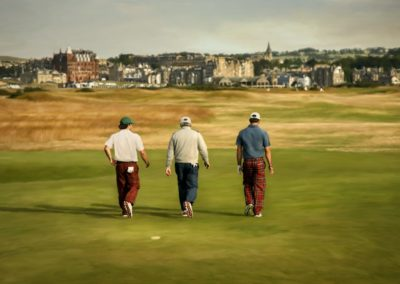 Back view of three guys walking on a golf course