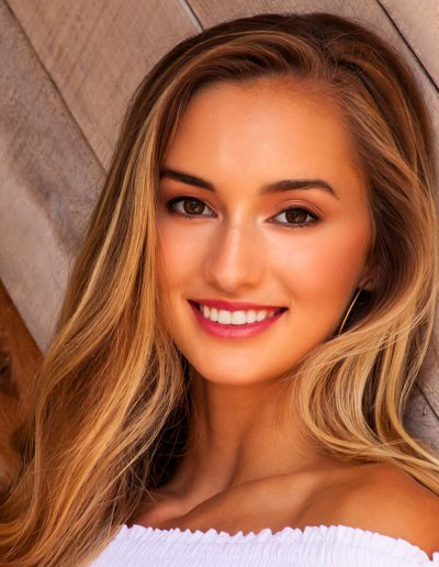 Close up of young blonde woman smiling